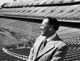 DENVER, CO--Jim Burris, Bears' general manager, contemplates the empty seats in Mile High Stadium...