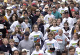 (DENVER, Colo., April 24, 2004)  Runners bunch up during the start of the 5K run event of the...
