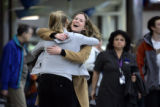 Twin sisters Kate (cq, right) and Sarah Cheesbrough (cq, left), both 23, embrace as they are...