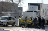 (AURORA, Colo., Dec. 05, 2005) Emergency workers work to remove the body of the cab driver as...