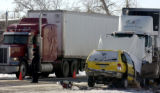 (AURORA, Colo., Dec. 05, 2005) Northbound traffic crawls by the scene of a van and semi collision...
