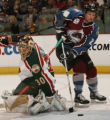 JPM226 - - Colorado Avalanche left wing Antti Laaksonen, right, reaches for the puck behind...