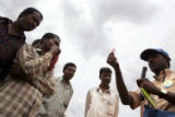 (NYT34) NELAMANGALA, India -- Dec. 5, 2005 -- INDIA-HIGHWAYS-AIDS-4 -- Truck drivers watch during...