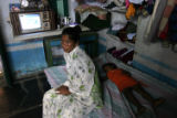(NYT33) CHILAKALURIPET, India -- Dec. 5, 2005 -- INDIA-HIGHWAYS-AIDS-3 -- A prostitute sits on her...