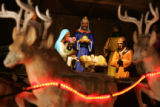 Santa's reindeer stand in front of a Nativity Scene at the Denver City and County Building on Dec....