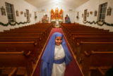 Beatrice Medina (cq), 8, smiles after being dressed as Mary before  the Posada, an annual...