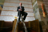 John Schafer (cq), general manager at the Hyatt Regency Denver, sits on a ladder in one of the...