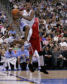 Denver Nuggets guard Earl Watson looks for a pass being defended by Houston Rockets guard Tracy...