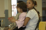 (DENVER, Colo.,  April 14, 2004) Delia(cq Delia from subject) Diaz,15, sits with her sister...