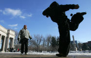 Henry Alexander, left, and Train Wreck, play hacky-sack to keep warm in Civic Center Park in...