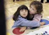 (L-R) Five year old twins Julia and Marisa Senkfor, from Greenwood Village put their hands on a...