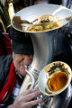 Paul Russell (cq) , with the Jeffco Community band, plays his 1921 double-belled euphonium at the...