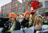 (L-R) Aimee Owen (cq), playing a marching baritone, and Kevin Braun (cq) playing a tuba, perform...