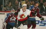 Ottawa Senators' Patrick Eaves, middle, celebrates scoring the first of four unanswered goals in...
