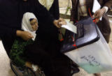(NYT3) BAGHDAD, Iraq -- Dec. 12, 2005 -- IRAQ-SECURITY-2 -- A hospitalized woman is assisted by a...