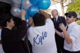 (4/20/04 Littleton, CO)  Attorney General Ken Salazar helps the Velasquez family get their...