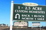 3.5 col. COLOR Signs along State Hwy 7 advertise new homes in Erie, Colorado Tuesday, December 27,...