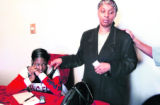 L to R:The mother of Kahleed Parker  Latonya Simmons (cq) sits in her home with Annie West...