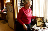 (YUMA., Colo., Dec. 12, 2005) Mary Rogers hold up the wedding photo of her and her husband Francis...