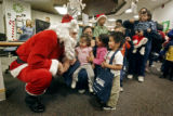 Santa Claus greets the first children waiting in line to see him at the Seventh Annual Denver...