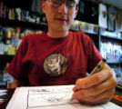 (DENVER COLORADO - April 25, 2004 ) Cartoonist  Ethan Wenberg  works on a page  as time is running...