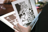 (DENVER COLORADO - April 25, 2004 ) Cartoonist  Craig Gassen looks threw  completed pages at...