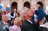 (Denver, Colo., April 12, 2004)  Pete Coors kisses his grandson Peter Hannson Coors II, 1...