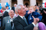 (Denver, Colo., April 12, 2004)  Pete Coors holds his grandson Peter Hannson Coors II, 1 year-old,...