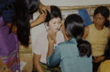Aurora, Co.  5/1/04. Cambodia copy photos.   Randa Yos gets her makeup done before the wedding...