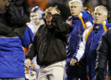 Greg Kreller / Idaho Press-Tribune Boise State head coach Dan Hawkins exits Bronco Stadium after...