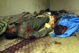 Tuesday, April 8, 2003-- Bodies of Iraqis, presumably killed by an invading US military, are seen...
