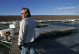 Todd Brophy, president of the Cherry Creek Marina and Yacht Club at Cherry Creek Reservoir,walks...