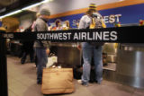 Southwest Airlines passengers arrive at Philadelphia International Airport December 29, 2005 in...