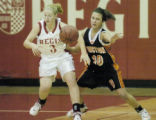 Brighton, CO December 16, 2005 Regis' Katie Mihalco battles with Grand Junction's Hannah Walsh for...