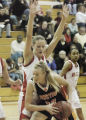 Brighton, CO December 16, 2005 Raysha Ritter of Grand Junction works the ball in against Aija...
