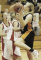 Brighton, CO December 16, 2005 Raysha Ritter of Grand Junction goes to the basket during the...