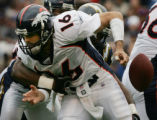JPM1529  Broncos quarterback Jake Plummer fumbles as Chargers linebacker Sean Phillips sacks him...