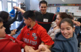 (CENTER BACKGROUND) North High School senior Nelson Villegas, 19, plays with students after...