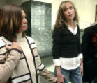 Kerri Gemeinhardt (cq) ,right, talks to the media outside of Adams County District Court  on...