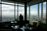 Edwin Jimenez, cq, Brighton, admires the view from Peaks Lounge, which is on the 27th floor of the...