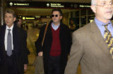 Joe Nacchio, center, arrives at Denver International Airport and follows his lead attorney Herbert...