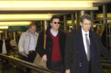 (CENTER) Joe Nacchio arrives at Denver International Airport and follows his lead attorney Herbert...