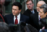 JPM576 Former Qwest CEO Joe Nacchio, left, talks to reporters as he leaves federal court on...