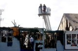 Ft. Collins, Colo., Photo taken April 25, 2004- Ft. Collins fire investigator examine apartment...