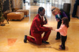 Alton Williams, left, sings to Rebecca Green, 3, and Marla Gifford, (no relation) in the lobby at...