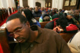 "Clarence Jones, cq, 39, naps while Chrismas hymns are played during the annual C.B. ""Father..."