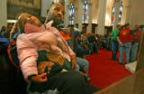 Orlando Terrell, 35, holds his daughter Keandra Hardy, 3, in the front pew Wednesday. Dec. 21,...