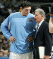 SPECIAL TO THE ROCKY MOUNTAIN NEWS--Denver Nuggets forward Eduardo Najera, left, of Mexico confers...
