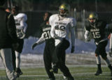 The University of Colorado football team takes the practice field  Thursday Dec. 8, 2005 in spite...