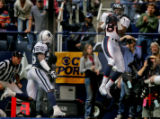 RG034 Denver Broncos' wide receiver, #80, Rod Smith, right, pulls down a 20-yard touchdown...